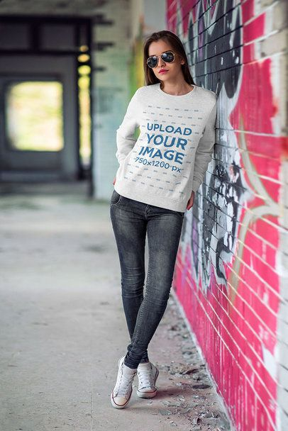 Mockup of a Woman Wearing a Heathered Crewneck Sweatshirt by a Graffiti Wall 4354-el1