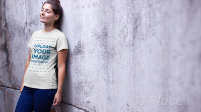 T-Shirt Video of a Relaxed Woman Leaning on a Concrete Wall 12891