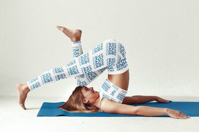 Mockup of a Woman with Sports Bra and Leggings Stretching on a Yoga Mat 34363-r-el2