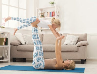 Mockup of a Mother and Her Daughter Doing Yoga in Matching Leggings 34534-r-el2