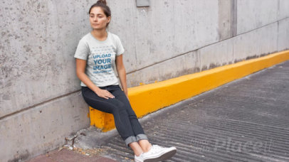 T-Shirt Video of a Woman Sitting By a Parking Lot Ramp 12892