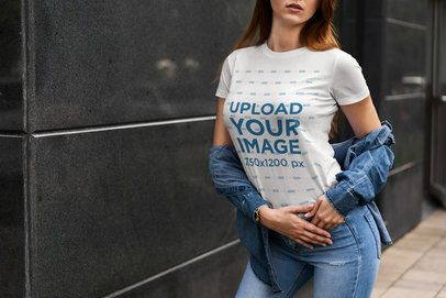 Cropped Face Mockup of a Woman Wearing a Customizable Crewneck T-Shirt by a Dark Wall 4301-el1
