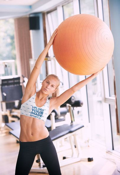 Sports Bra Mockup Featuring a Fit Woman Exercising with a Yoga Ball 34508-r-el2
