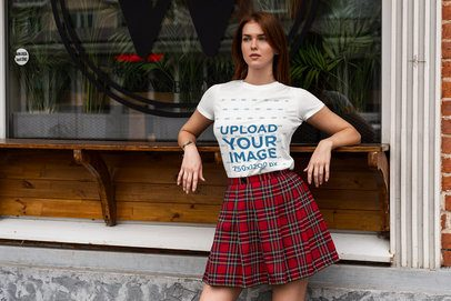 T-Shirt Mockup of a Woman with a Preppy Look Posing Outside a Restaurant 4305-el1