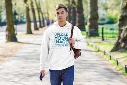 Pullover Hoodie Mockup of a Man Walking Through a Park 34171-r-el2