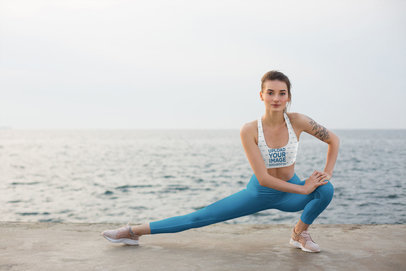 Mockup of a Woman with a Sports Bra Doing Yoga by the Beach 34740-r-el2