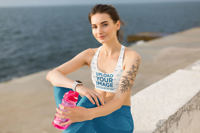 Sports Bra Mockup of a Woman with a Tattoo Sitting by the Ocean 34741-r-el2