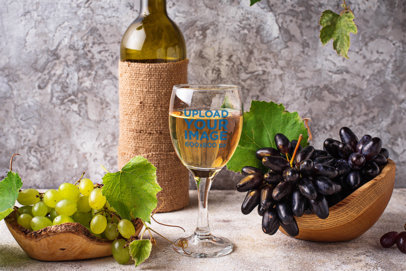 Wine Glass Mockup Featuring Grapes and a Wine Bottle 36646-r-el2