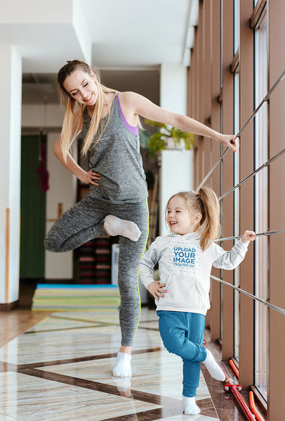 Hoodie Mockup of a Little Girl Practicing Ballet with Her Mom 34317-r-el2
