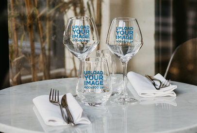 Mockup of Three Wine Glasses on a Restaurant's Table 36448-r-el2