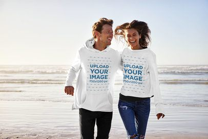 Pullover Hoodie Mockup Featuring a Happy Man and His Wife at the Beach 34350-r-el2