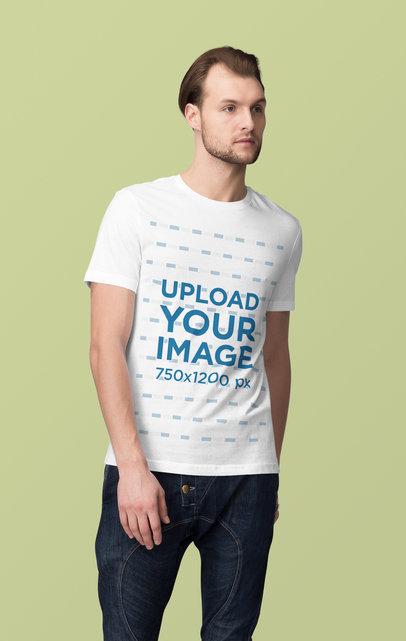 Mockup of a Serious Man Posing at a Studio and Wearing a Customizable T-Shirt 4366-el1