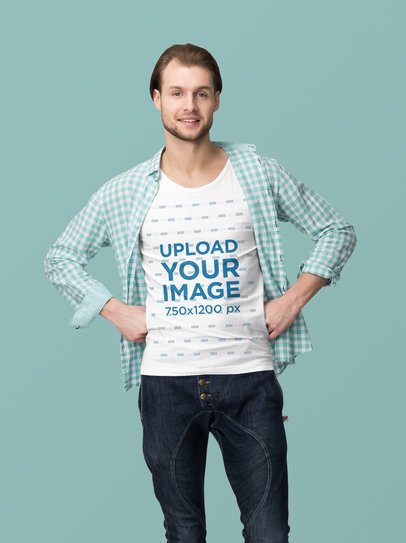 Tee Mockup of a Man at a Studio Posing with Hands on His Waist 4368-el1