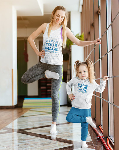 Tank Top Mockup of a Mom and Her Daughter with a Hoodie Practicing Ballet 34310-r-el2