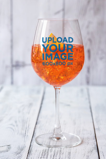 Mockup of a Wine Glass Filled with a Cold Orange-Infused Drink 36616-r-el2