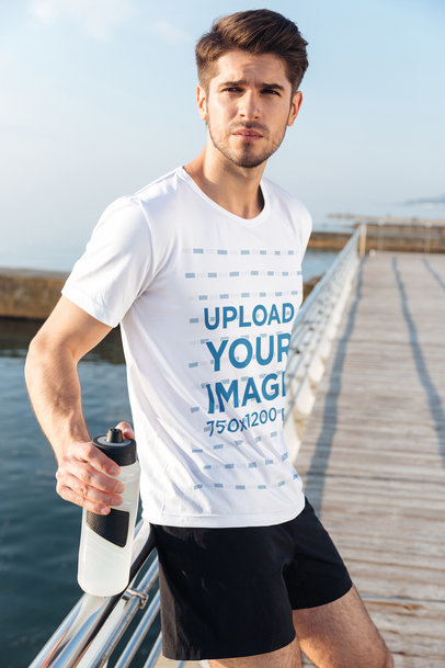 Activewear T-Shirt Mockup of a Man Leaning on a Handrail by the Beach 34519-r-el2