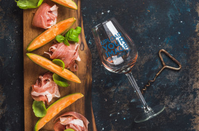 Mockup of a Wine Glass Next to a Charcuterie Board 36827-r-el2