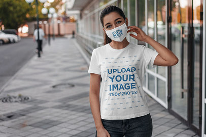 Mockup of a Young Woman Wearing a T-Shirt and a Face Mask on the Street 4554-el1