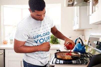 Mockup of a Man with a Heathered T-Shirt Cooking 34546-r-el2