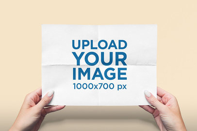Mockup Featuring Two Hands Holding a Horizontal Flyer Against a Solid Color Backdrop 4524-el1