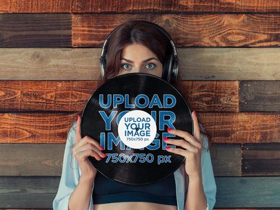 Mockup of a Woman with Headphones Holding a Vinyl Record 36726-r-el2