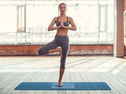 Mockup of a Woman Doing a Standing Meditation on a Yoga Mat 37098-r-el2