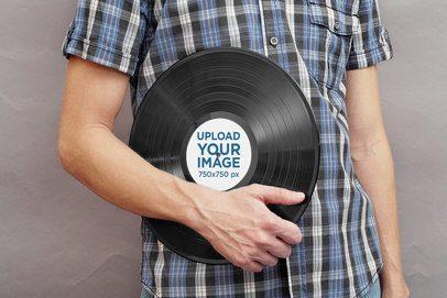 Mockup of a Man Holding a Vinyl Record 37279-r-el2