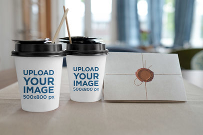 Mockup Featuring Two Customizable Coffee Cups and a Letter 36533-r-el2