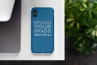 Phone Case Mockup Featuring Some Plants in the Background 4628-el1