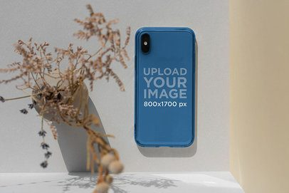 Minimal Mockup of a Clear Phone Case Placed Next to a Plant 4601-el1