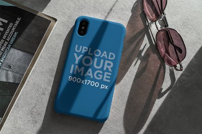 Mockup of a Phone Case Placed Next to a Pair of Sunglasses 4617-el1
