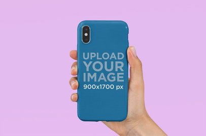 Mockup of a Woman Holding a Phone Case Against a Plain Background 4646-el1
