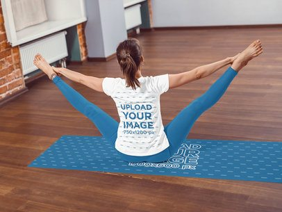 Back View T-Shirt Mockup of a Woman Stretching Her Legs on a Yoga Mat 37090-r-el2