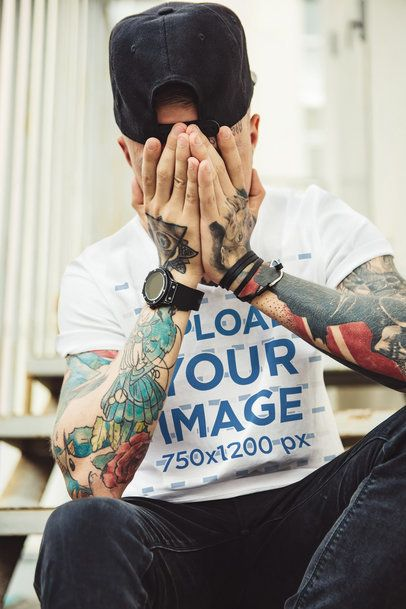 Mockup of a Man with Tattoos Wearing a T-Shirt with Folded Sleeves 37525-r-el2