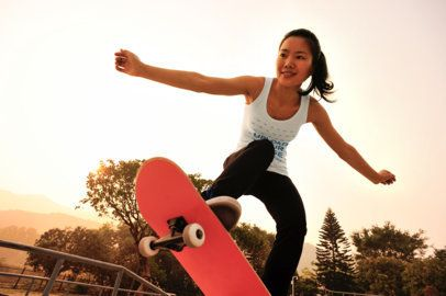 Tank Top Mockup of a Woman Riding Her Skateboard 37460-r-el2