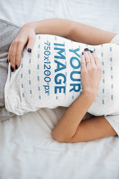 T-Shirt Mockup of a Pregnant Woman Lying on Her Bed 37241-r-el2