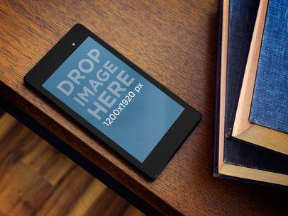 Google Nexus7 Black Portrait Next To Books