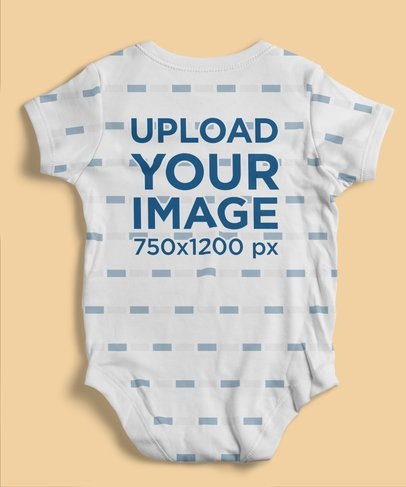 Back-View Mockup of an Onesie Laid Flat on a Surface 4597-el1