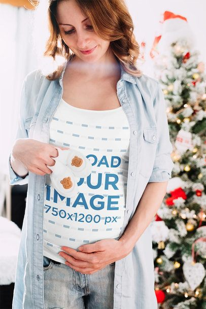 T-Shirt Mockup of a Pregnant Woman in Front of a Christmas Tree 37256-r-el2