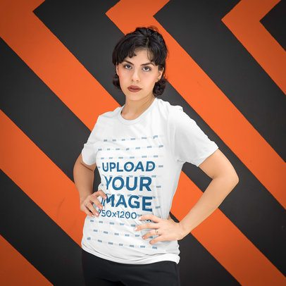 T-Shirt Mockup Featuring a Woman Standing in Front of a Patterned Wall 4704-el1