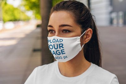 Mockup of a Woman Wearing a Customizable Face Mask in the City 4670-el1