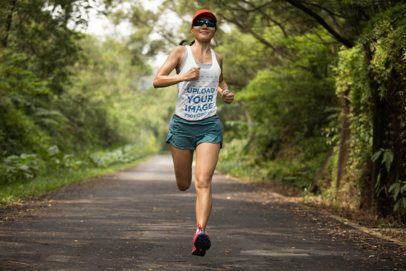 Tank Top Mockup of a Woman Running on a Tree-Filled Road 37961-r-el2