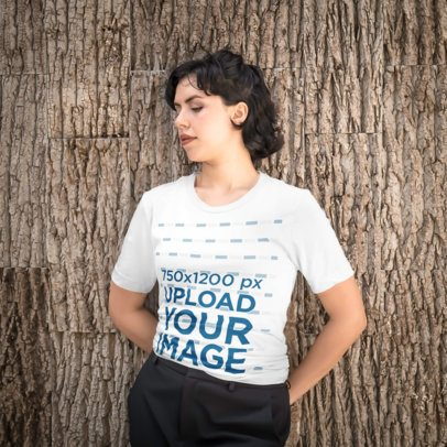 T-Shirt Mockup of a Short-Haired Woman Standing Against a Textured Wall 4708-el1