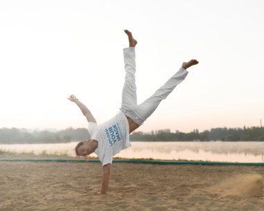 T-Shirt Mockup of a Man Doing a One Arm Handstand 38140-r-el2