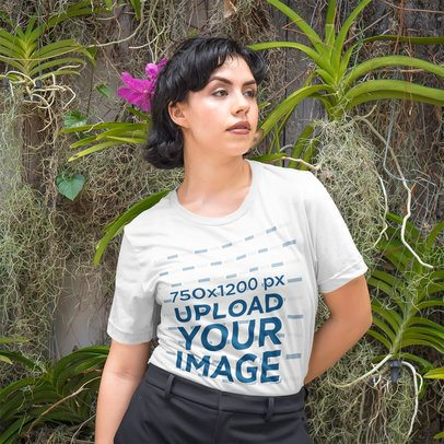 T-Shirt Mockup of a Fierce Woman Posing in Front of a Nature Wall 4710-el1