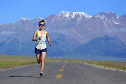 Tank Top Mockup of a Woman Running with Mountains in the Background 38259-r-el2