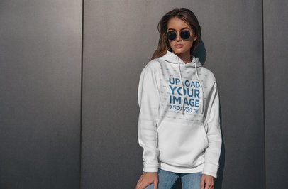 Hoodie Mockup of a Woman With Sunglasses Standing Against a Metallic Wall 4779-el1