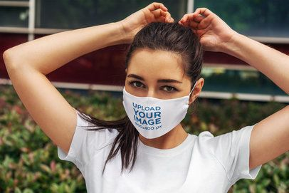 Face Mask Mockup of a Woman Fixing Her Ponytail 4677-el1