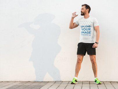 Heather T-Shirt Mockup of a Sporty Man Drinking Water 38208-r-el2