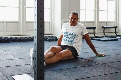 T-Shirt Mockup of a Man Sitting on a Gym's Floor 37232-r-el2
